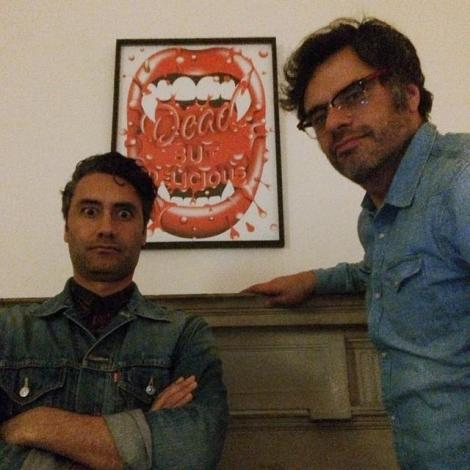 Taika and Jemaine in front of WWDitS poster commisioned by Steven Wilson for the Summer Screen Prints Film Poster Exhibition. Photo by Print Club London
